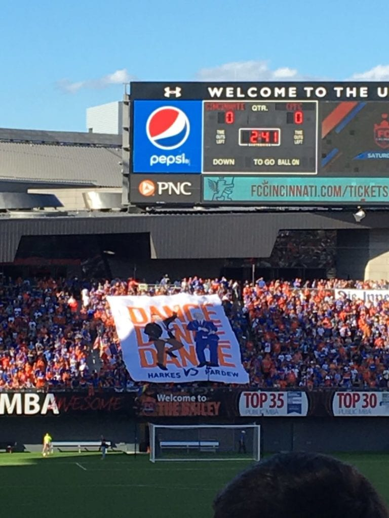 "Supporters groups in ""The Bailey"" unveil a John Harkes and Alan Pardew banner right before kickoff."